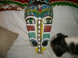 tribal mask on recycled palm bark